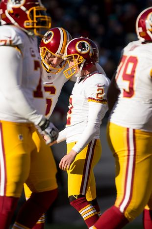 Washington Redskins kicker Kai Forbath (2) celebrates with teammates after kicking one of two field goals in the second quarter as the Washington Redskins play the Philadelphia Eagles at Lincoln Financial Field, Philadelphia, Pa., Sunday, December 23, 2012. (Andrew Harnik/The Washington Times)