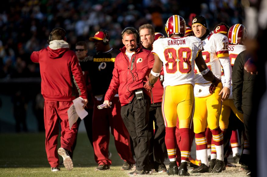 Washington Redskins head coach Mike Shanahan, center, celebrates after Washington Redskins wide receiver Santana Moss (89) catches a 22 yard touchdown pass late in the third quarter as the Washington Redskins play the Philadelphia Eagles at Lincoln Financial Field, Philadelphia, Pa., Sunday, December 23, 2012. (Andrew Harnik/The Washington Times)