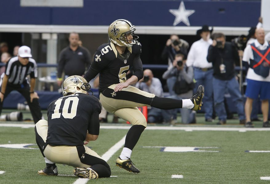New Orleans Saints kicker Garrett Hartley (5) watches his game winning field goal with teammate Chase Daniel (10) during overtime play of an NFL football game against the Dallas Cowboys Sunday, Dec. 23, 2012, in Arlington, Texas. The Saints won 34-31. (AP Photo/Sharon Ellman)