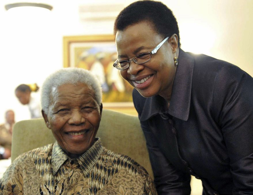 Former South African President Nelson Mandela and his wife, Graca Machel, are pictured after they cast early ballots in local elections at their home in Johannesburg on Monday, May 16, 2011. (AP Photo/Elmond Jiyane, South African Government Communications and Information Services)