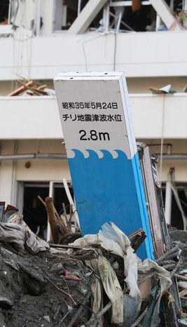 The west coast of Canada and the United States have few warning signs or reminders, like this one in Japan, of the earthquakes and tsunamis that have struck the region with killer force. (Associated Press)