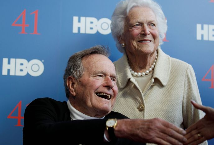Former President George H.W. Bush, who was the subject of a recent HBO documentary, remains hospitalized in Houston. Wife Barbara and other family members will spend Christmas with him there. (Associated Press)