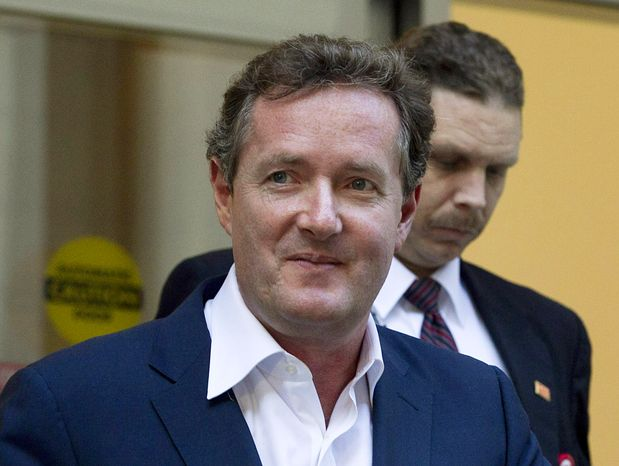 "** FILE ** Piers Morgan, host of CNN's ""Piers Morgan Tonight,"" leaves the CNN building in Los Angeles on Tuesday, Dec. 20, 2011. (AP Photo/Jae C. Hong)"