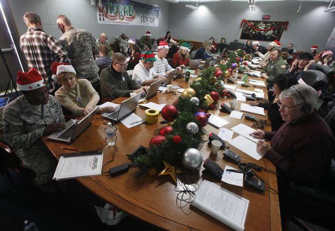Volunteers take phone calls from children asking where Santa is and when he will deliver presents to their house during the annual NORAD Tracks Santa Operation at the North American Aerospace Defense Command (NORAD) at Peterson Air Force Base in Colorado Springs, Colo., on Monday Dec. 24, 2012. More than a thousand volunteers at NORAD handle more than 100,000 thousand phone