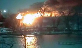 Two volunteer firefighters were shot to death and two others were wounded when they responded to a lakeshore house fire before dawn on Monday, Dec. 24, 2012, in Webster, N.Y. (AP Photo/WHAM-TV via AP video)