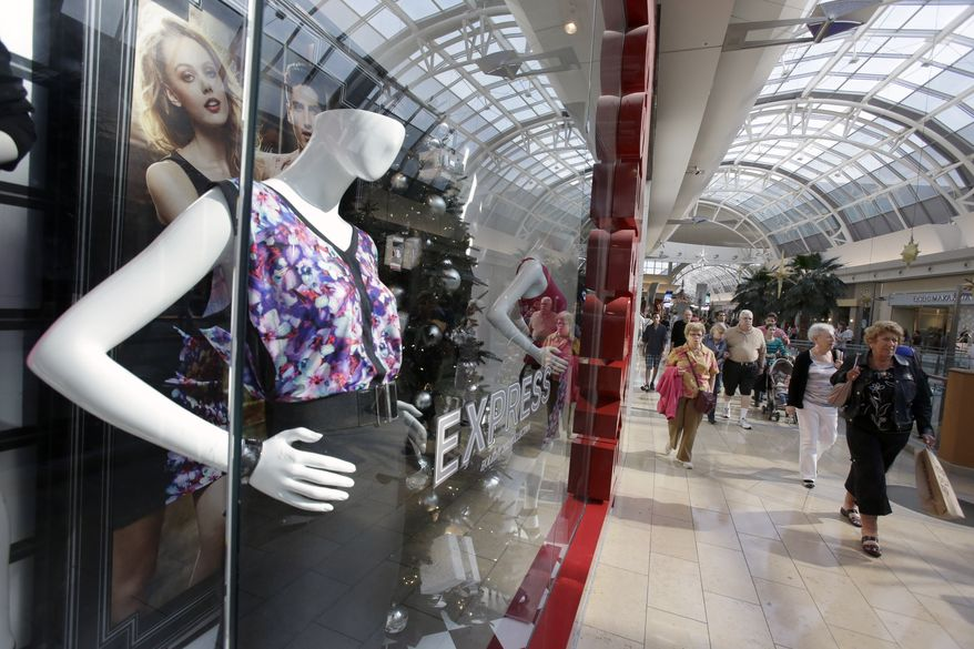 Shoppers walk through a mall in Orlando, Fla., on Thursday, Dec. 20, 2012. (AP Photo/John Raoux)
