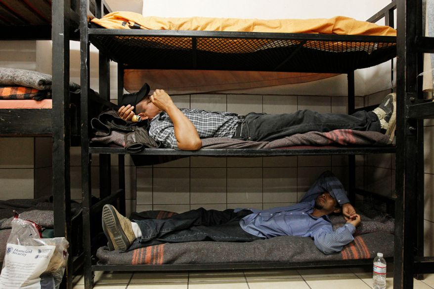 ** FILE ** Antonio Perez (bottom) joins dozens of others, many of them Mexican citizens, as they relax in sleeping quarters at a well-known immigrant shelter on Thursday, Aug. 9, 2012, in Nogales, Mexico. Many are making tough decisions on whether to try their luck at making it to the United States by illegally crossing the border. (AP Photo/Ross D. Franklin)