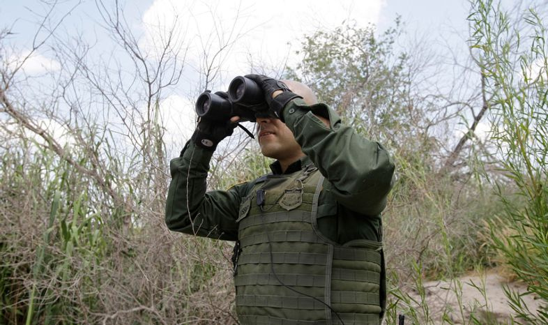 U.S. Customs and Border Patrol Agent Sanchez patrols along the Rio Grande River on Wednesday, June 8, 2011, in Penitas, Texas. Between October 2009 and March 2011, the Border Patrol detained at least 2,600 illegal immigrants from India, a dramatic spike, considering apprehensions of Indian border-jumpers had historically hovered between 150 and 300 per year. (AP Photo/Eric Gay)