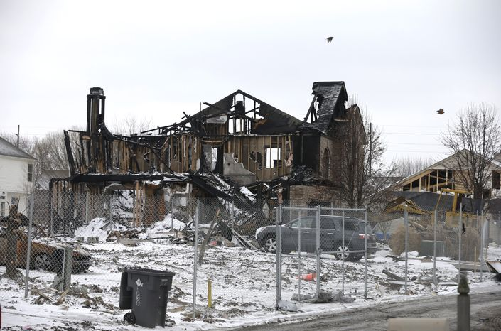 A house in the Richmond Hills neighborhood on the south side of Indianapolis was destroyed in an explosion that prosecutors say was set by the homeowner, her boyfriend and his brother. (AP Photo/Darron Cummings)