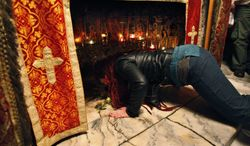 A Christian worshipper prays inside the Grotto at the Church of the Nativity, traditionally believed by Christians to be the birthplace of Jesus Christ, in the West Bank town of Bethlehem on Monday, Dec. 24, 2012. (AP Photo/Adel Hana)