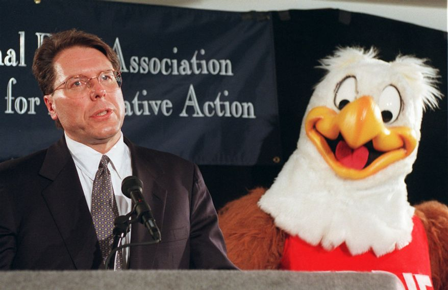 National Rifle Association gun-safety mascot Eddie Eagle stands beside Wayne LaPierre, NRA executive vice president and CEO, during a news conference in Washington on Friday, Feb. 28, 1997, to mark the third anniversary of the Brady Act. (AP Photo/Dennis Cook)