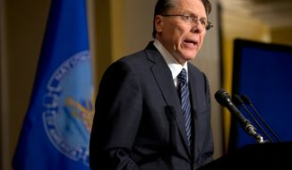 "** FILE ** Wayne LaPierre, executive vice president and CEO of the National Rifle Association, speaks during a news conference in Washington on Friday, Dec. 21, 2012, in response to the Newtown, Conn., school shooting the week before. The NRA, the nation's largest gun-rights lobby, is calling for armed police officers to be posted in every American school to stop the next killer ""waiting in the wings."" (Associated Press)"