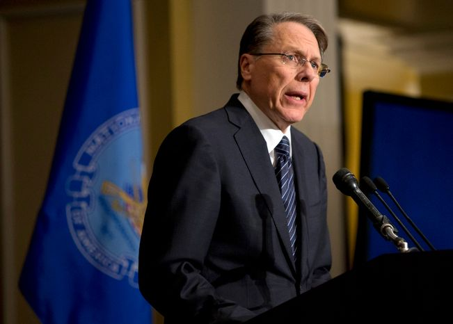 """** FILE ** Wayne LaPierre, executive vice president and CEO of the National Rifle Association, speaks during a news conference in Washington on Friday, Dec. 21, 2012, in response to the Newtown, Conn., school shooting the week before. The NRA, the nation's largest gun-rights lobby, is calling for armed police officers to be posted in every American school to stop the next killer """"waiting in the wings."""" (Associated Press)"""