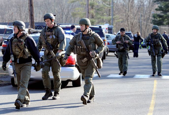 **FILE** Connecticut State Police are on scene following the mass shooting at the Sandy Hook Elementary School in Newtown, Conn., about 60 miles northeast of New York, on Dec. 14, 2012. (Associated Press)