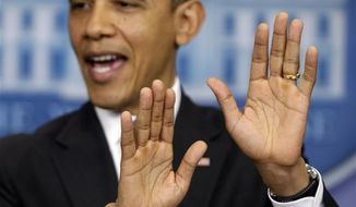 """President Obama gestures as he speaks about """"fiscal cliff"""" negotiations on Wednesday, Dec. 19, 2012, at the White House in Washington. (AP Photo/Charles Dharapak)"""