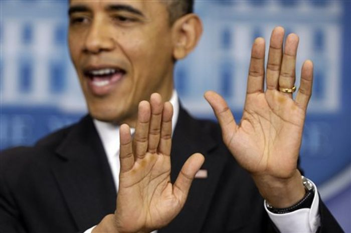 "President Obama gestures as he speaks about ""fiscal cliff"" negotiations on Wednesday, Dec. 19, 2012, at the White House in"