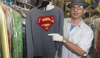 "James Comisar holds the costume George Reeves wore in the 1950s TV show ""The Adventures of Superman,"" part of Mr. Comisar's television memorabilia collection stored in a temperature- and humidity-controlled warehouse in Los Angeles. (AP Photo/Damian Dovarganes)"