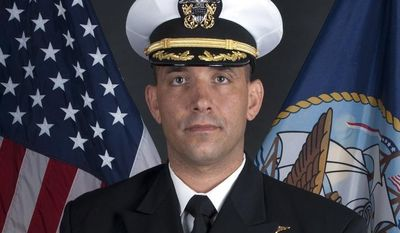 U.S. Navy Cmdr. Job W. Price, 42, of Pottstown, Pa., died on Saturday, Nov. 22, 2012, of a gunshot wound to the head while supporting stability operations in Uruzgan Province in Afghanistan. (AP Photo/U.S. Navy)
