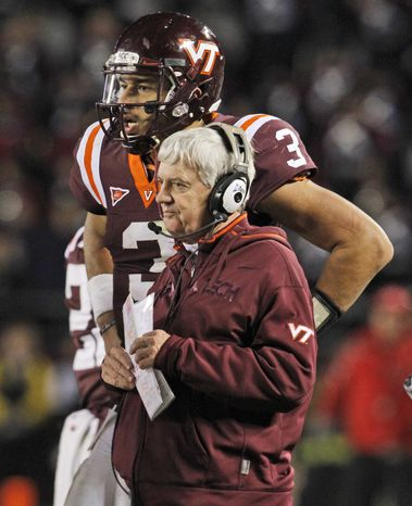 FILE - In this Nov. 8, 2012 file photo, Virginia Tech head coach Frank Beamer, right, and Logan Thomas (3) talk during the second half of an NCAA college football game in Blacksburg, Va. Beamer set Wednesday as the day for the Hokies' scouting report of Russell Athletic Bowl opponent Rutgers to be completed and for their focus to shift to game-specific drills. (AP Photo/Steve Helber, File)