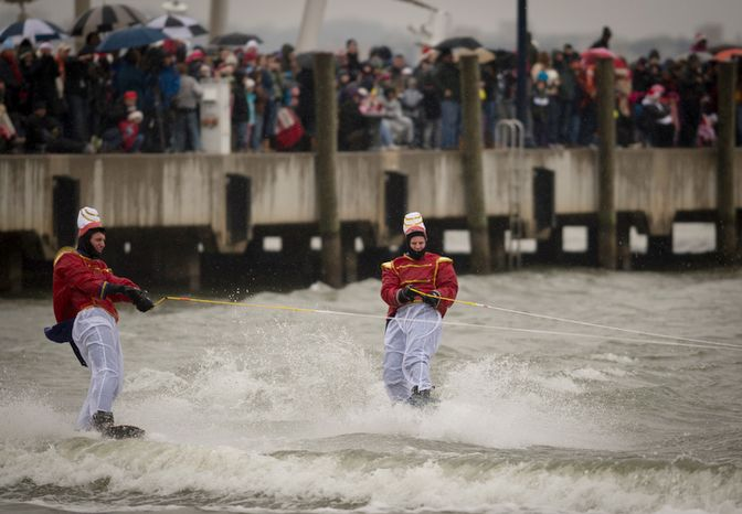 Dressed in toy soldier costumes, men take to the water on water skis on Christmas eve.  (Rod Lamkey Jr./The Washington Times)