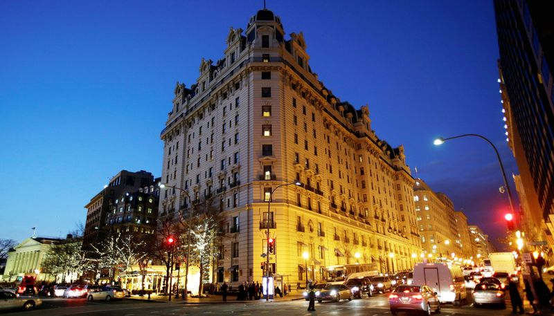** FILE ** In this Dec. 19, 2012, file photo, the Willard Hotel is seen at dusk in Washington. At the Willard, about a block from the White House, rooms are still available for the presidential inauguration starting at more than $1,100 a night with a four-night minimum. That means every guest will pay more than President Abraham Lincoln did when he checked out after his 1861 inauguration and paid $773.75 for a stay of more than a week. (AP Photo/Jacquelyn Martin)