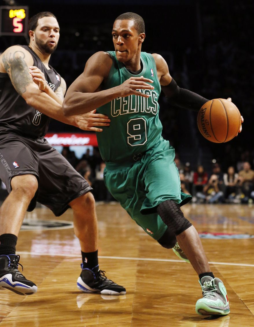 Boston Celtics guard Rajon Rondo (9) drives to the basket against Brooklyn Nets guard Deron Williams (8) in the second half of their NBA basketball game at Barclays Center, Tuesday, Dec. 25, 2012, in New York. Boston won 93-76. (AP Photo/John Minchillo)