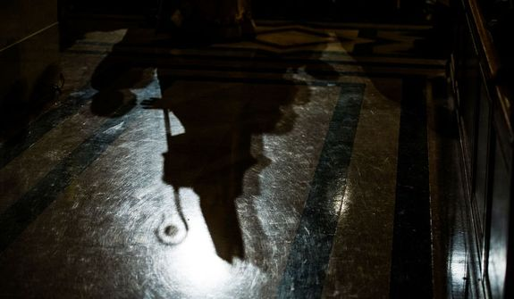The shadow of Archbishop of Washington Cardinal Donald Wuerl can be seen as he joins a processional for the Solemn Mass of Christmas Day at the Basilica of the National Shrine of the Immaculate Conception, Washington, D.C., Tuesday, December 25, 2012. (Andrew Harnik/The Washington Times)