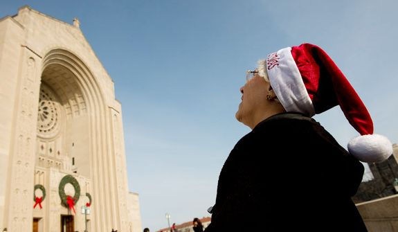 Pat Beronio of Martinsville, NJ. looks up at the Basilica of the National Shrine of the Immaculate Conception after Archbishop of Washington Cardinal Donald Wuerl leads a congregation of 4,000 in Solemn Mass of Christmas Day, Washington, D.C., Tuesday, December 25, 2012. (Andrew Harnik/The Washington Times)