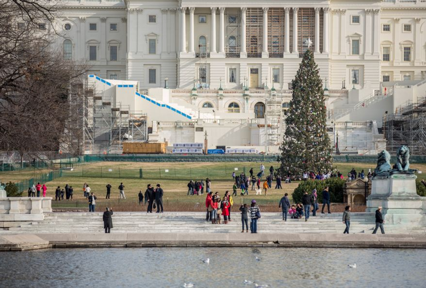 The focus of the Capitol's West Lawn soon will shift from the Capitol Christmas Tree to Inauguration Day, with hotel rooms still available for that weekend. (Andrew S. Geraci/The Washington Times)