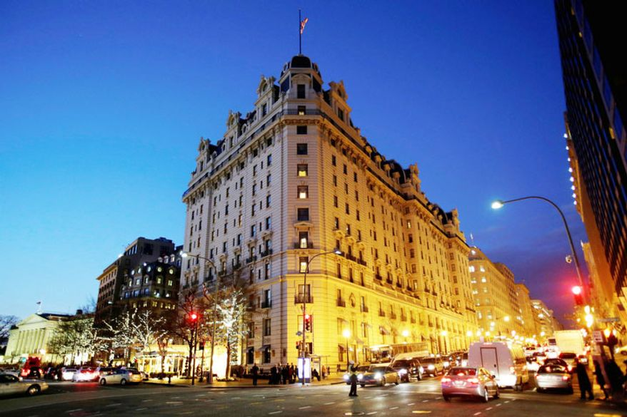 The Willard Hotel is seen at dusk in Washington. At the Willard, about a block from the White House, rooms are still available for the presidential inauguration starting at more than $1,100 a night with a four-night minimum. That means every guest will pay more than President Abraham Lincoln did when he checked out after his 1861 inauguration and paid $773.75 for a stay of more than a week. (AP Photo/Jacquelyn Martin)