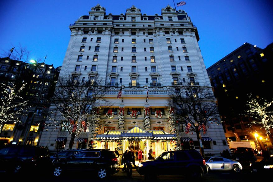 In this Wednesday, Dec. 19, 2012, file photo, the Willard Hotel is seen at dusk in Washington. (AP Photo/Jacquelyn Martin)