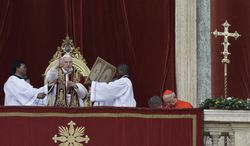 "Pope Benedict XVI delivers his ""Urbi et Orbi"" ('To the City and to the World"") speech from the central loggia of St. Peter's Basilica at the Vatican on Tuesday, Dec. 25, 2012. (AP Photo/Gregorio Borgia)"