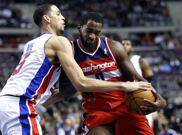 Detroit Pistons forward Austin Daye, left, gets his hand on the ball but is whistled for fouling Washington Wizards forward Martell Webster, right, during the first half of an NBA basketball game in Auburn Hills, Mich., Friday, Dec. 21, 2012. (AP Photo/Duane Burleson)