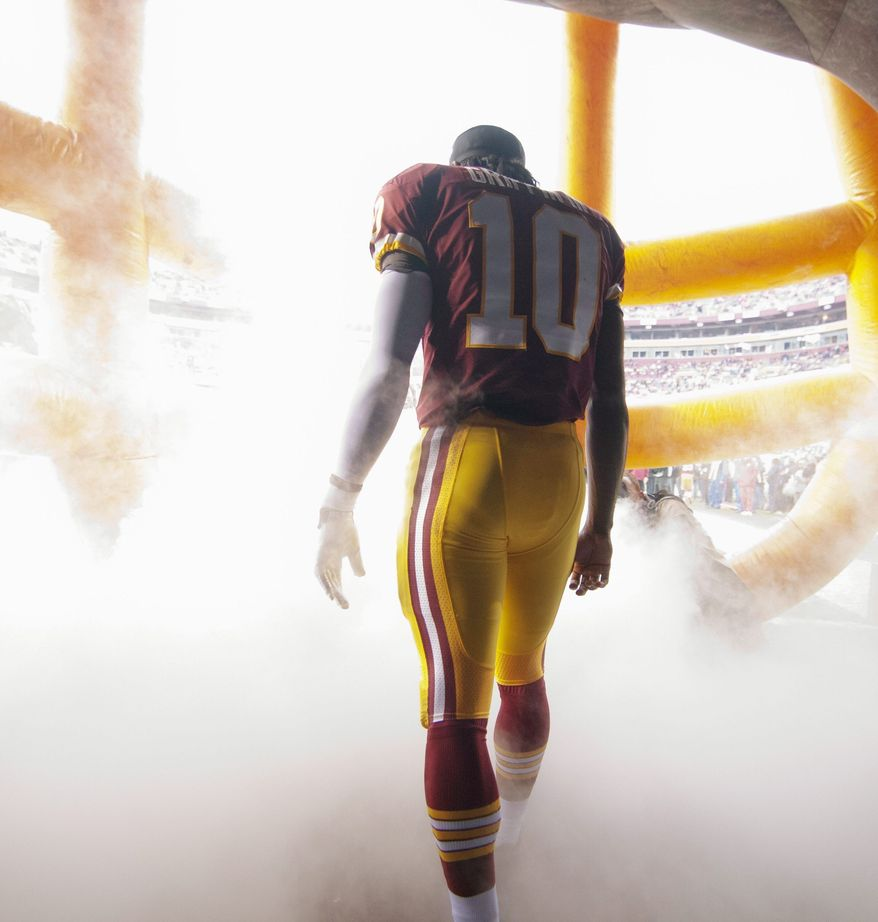 Redskins quarterback Robert Griffin III can add to his growing list of accomplishments by winning the NFC East title. (Craig Bisacre/The Washington Times)