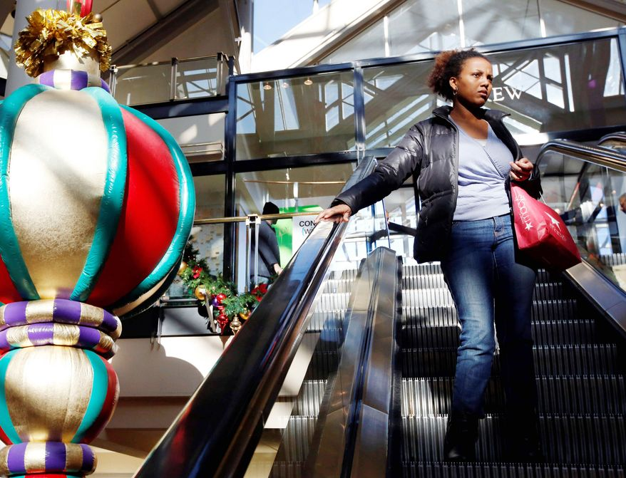 Holiday ornaments, but not last-minute shoppers, filled malls as Christmas approached. Consumer sentiment plunged this month after hitting four-year highs in November, dampening sales for retailers despite deep discounts and other incentives. (Associated Press)