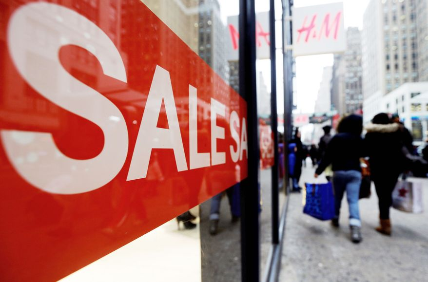 Shoppers walk past an H&M location, Wednesday, Dec. 26, 2012, in New York. This holiday season is shaping up to be the weakest since the country was in the middle of a deep recession in 2008. That not only shows that stores misread Americans' willingness to spend during this period of economic uncertainty, it also could indicate that the days of shoppers spending thousands of dollars willy nilly on holiday gifts may be long gone. (Associated Press)