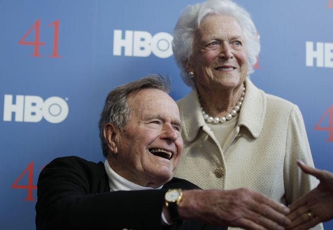 **FILE** Former President George H.W. Bush and his wife, former first lady Barbara Bush, arrive June 12, 2012, for the premiere of HBO's new documentary on his life near the family compound in Kennebunkport, Maine. (Associated Press)