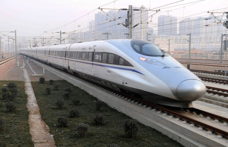 In this photo released by China's Xinhua news agency, a high-speed train G802 leaves for Beijing from Shijiazhuang, capital of north China's Hebei province, on Dec. 26, 2012. China has opened the world's longest high-speed rail line, which runs 2,298 kilometers (1,428 miles) from the country's capital in the north to Guangzhou, an economic hub in the Pearl River delta in southern China. (Associated Press/Xinhua)
