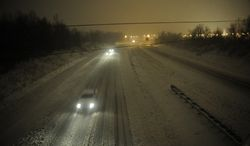 Motorists travel slowly on a snow-covered Interstate 24 in Paducah, Ky., during a winter storm on Dec. 26, 2012. The storm dumped several inches of snow, making travel hazardous. (Associated Press)