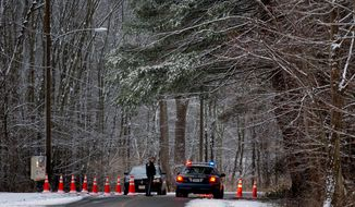 Police continue to block the road to Sandy Hook Elementary School in Newtown, Conn., on Dec. 25, 2012. (Associated Press)