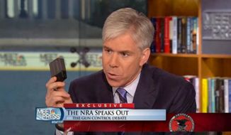 "Screen shot from ""Meet the Press"" of David Gregory speaking to Wayne LaPierre.  (NBC)"