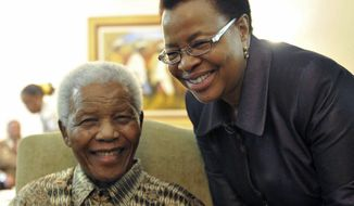** FILE ** This May 16, 2011, file photo supplied by the South African Government Communications and Information Services, GCIS, shows former South African President Nelson Mandela and his wife Graca Machel after they cast an early ballot in upcoming local elections at his home in Johannesburg, South Africa. (AP Photo/Elmond Jiyane-GCIS, File)