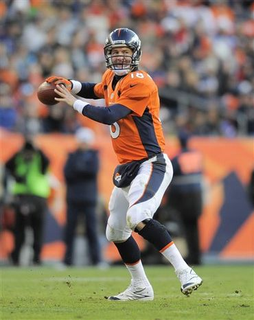 In this Dec. 23, 2012, photo, Denver Broncos quarterback Peyton Manning sets up to throw a pass against the Cleveland Browns in the fourth quarter of an NFL game in Denver. Manning was selected to the Pro Bowl on Wednesday, Dec. 26, 2012. (AP Photo/Jack Dempsey)
