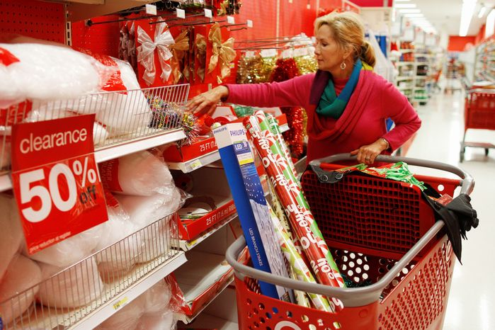** FILE ** Holly Bryan stocks up on Christmas wrapping paper and other holiday items while shopping for day after Christmas deals at a Target store in Chattanooga, Tenn., Wednesday, Dec. 26, 2012. (AP Photo/Chattanooga Times Free Press, Dan Henry)