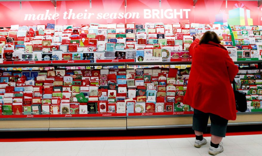In this Wednesday, Dec. 19, 2012, photo, a customer shops for greeting cards at a Target store in Chicago. U.S. holiday retail sales this year are the weakest since 2008, after a shopping season disrupted by storms and rising uncertainty among consumers. (AP Photo/Nam Y. Huh)