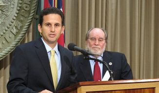 Hawaii Lt. Gov. Brian Schatz speaks the state Capitol in Honolulu on Wednesday, Dec. 26. 2012 after Gov. Neil Abercrombie, right, announced he was appointing Schatz to fill the seat vacated by the late U.S. Sen. Daniel Inouye. (Associated Press)