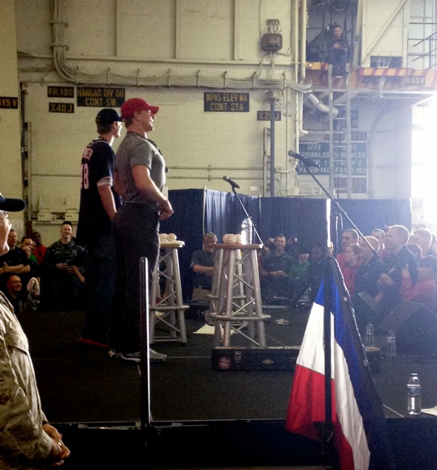 A USO Show on the U.S.S. John C. Stennis with Washington Capital player Matt Hendricks is wearing a red hat with Washington Nationals player Ross Detwiler at right.  (Courtesy Matt Hendricks)