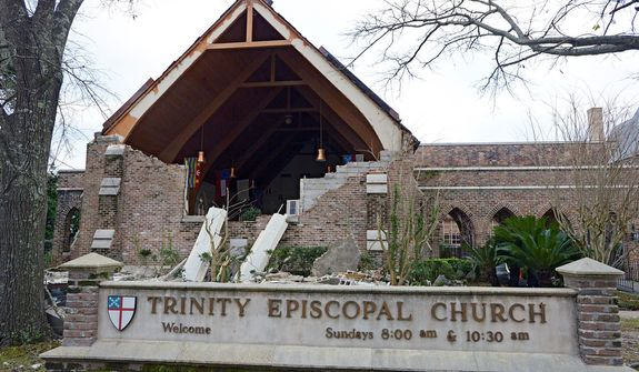 This Wednesday, Dec. 26, 2012 photo shows a damaged hall at Trinity Episcopal Church as residents clean up and assess the damage from a Christmas Day tornado in Mobile, Ala.  (AP Photo/G.M. Andrews)