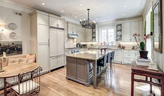 The kitchen has granite counters and top-of-the-line appliances.