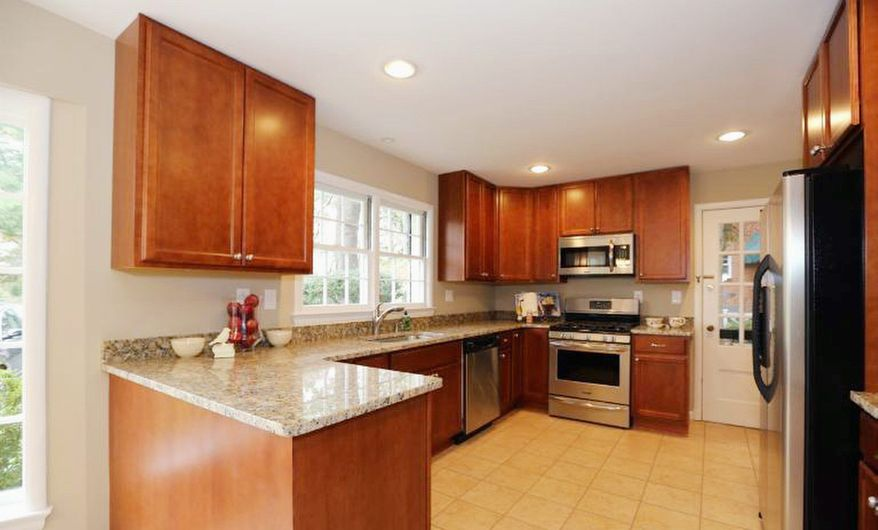 The kitchen has new granite counters, maple cabinets and stainless steel appliances.